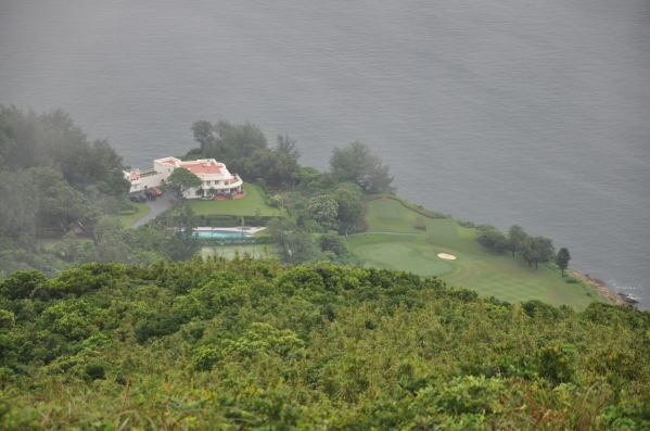 Exclusive mansion homes dot the coast
